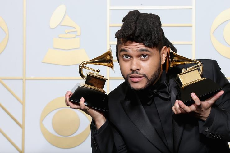 The Weeknd with his two Grammys at the 58th annual Grammy Awards