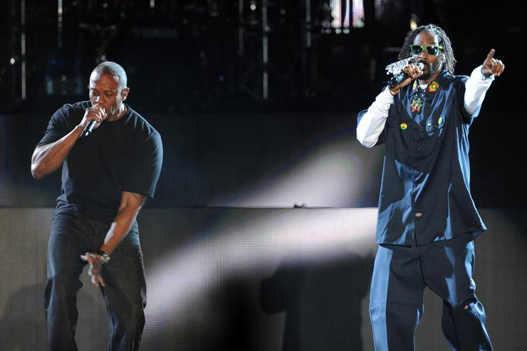 Rappers Dr. Dre (L) and Snoop Dogg perform onstage during day 3 of the 2012 Coachella Valley Music & Arts Festival at the Empire Polo Field on April 15, 2012 in Indio, California.