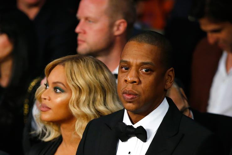 Jay Z and Beyonce at a boxing match.