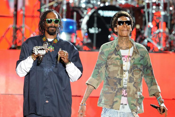 Rappers Snoop Dogg (L) and Wiz Khalifa perform onstage during day 3 of the 2012 Coachella Valley Music & Arts Festival at the Empire Polo Field on April 15, 2012 in Indio, California. (