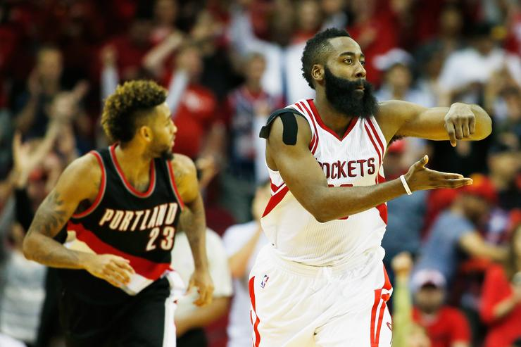 James Harden #13 of the Houston Rockets celebrates after he hit a three-point shot near the end of the fourth quarter against the Portland Trail Blazers during their game at the Toyota Center on November 18, 2015 in Houston, Texas.