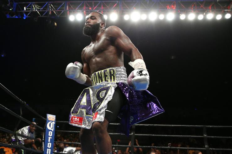 Adrien Broner celebrates after defeating Ashley Theophane (not pictured) by TKO in ninth round in their super lightweight championship bout at the DC Armory on April 1, 2016 in Washington, DC.