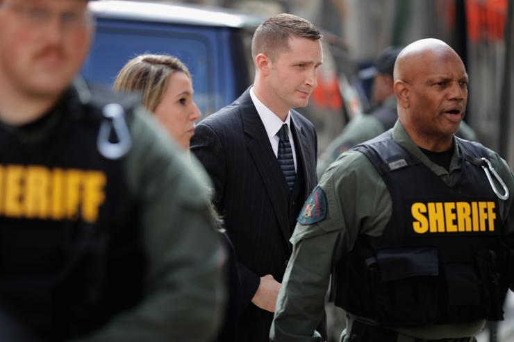Baltimore Police Officer Edward Nero (C) arrives at the Mitchell Courthouse-West on the day a judge will issue a vertict in his trial May 23, 2016 in Baltimore, Maryland. Nero is one of six police officers charged in the arrest and death of Freddie Gray, whose injuries while in police custody resluted in his death and sparked days of protests and riots in Baltimore last year.
