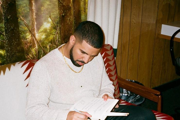 Drake writing in his notebook