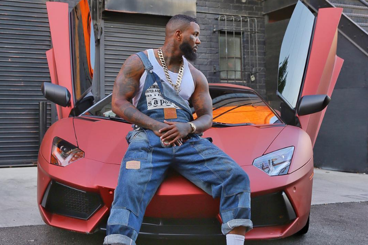 The Game posted with his car
