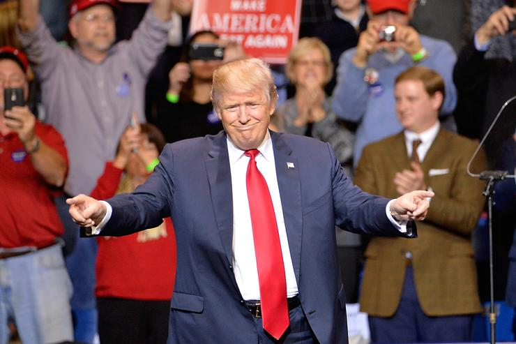 President-elect Donald Trump points to his supporters during his 'Thank You' rally at Crown Coliseum on December 6, 2016 in Fayetteville, North Carolina. Trump took time off from selecting the cabinet for his incoming administration to celebrate his victory in the general election.