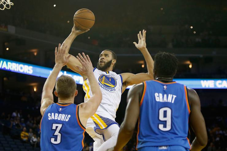 JaVale McGee #1 of the Golden State Warriors goes to the basket against Domantas Sabonis #3 and Jerami Grant #9 of Oklahoma City Thunder at ORACLE Arena on November 3, 2016 in Oakland, California.