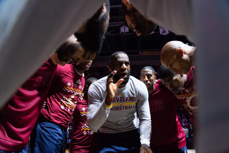 LeBron James #23 of the Cleveland Cavaliers rallies his teammates in the huddle during player introductions prior to the game Golden State Warriors at Quicken Loans Arena on December 25, 2016 in Cleveland, Ohio.