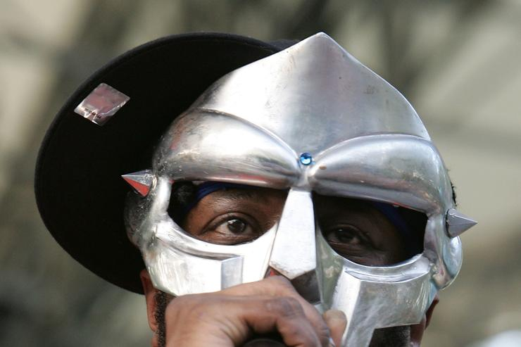 Rapper MF DOOM performs at a benefit concert for the Rhino Foundation at Central Park's Rumsey Playfield on June 28, 2005 in New York City.