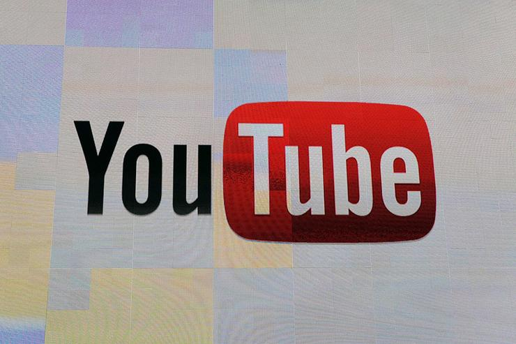 The YouTube logo appears on screen before a keynote address by Vice President of Global Content Partnerships at YouTube Robert Kyncl at the 2012 International Consumer Electronics Show at the Las Vegas Hotel & Casino January 12, 2012 in Las Vegas, Nevada. CES, the world's largest annual consumer technology trade show, runs through January 13 and features more than 3,100 exhibitors showing off their latest products and services to about 140,000 attendees.