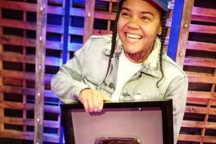Young M.A. receiving plaque from YouTube