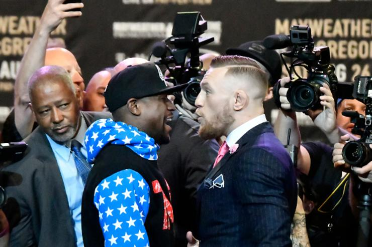 Mayweather faces off with McGregor at first presser