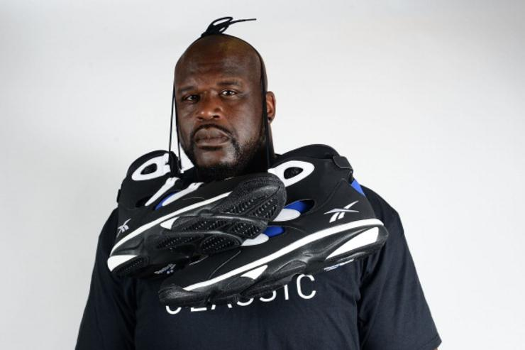 Shaq poses with his Reeboks