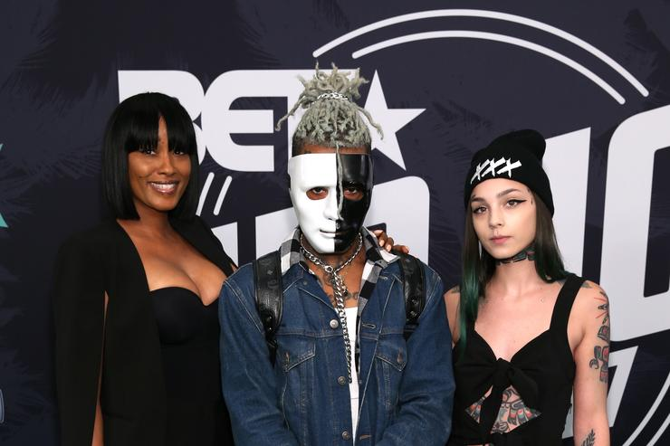 Rapper XXXTentacion (C) attends the BET Hip Hop Awards 2017 at The Fillmore Miami Beach at the Jackie Gleason Theater on October 6, 2017 in Miami Beach, Florida.