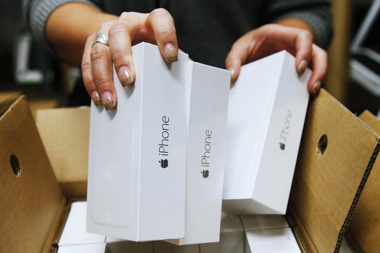 n Apple iPhone 6 phones are taken out of a shipping box at a Verizon store on September 18, 2014 in Orem, Utah. Apple's new iPhone 6 and iPhone 6 Plus go on sale September 20