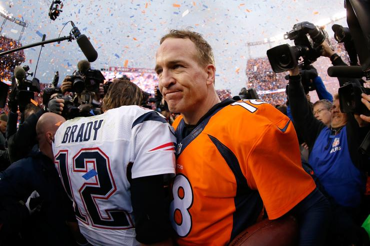 Peyton Manning #18 of the Denver Broncos and Tom Brady #12 of the New England Patriots speak after the AFC Championship game at Sports Authority Field at Mile High on January 24, 2016 in Denver, Colorado. The Broncos defeated the Patriots 20-18