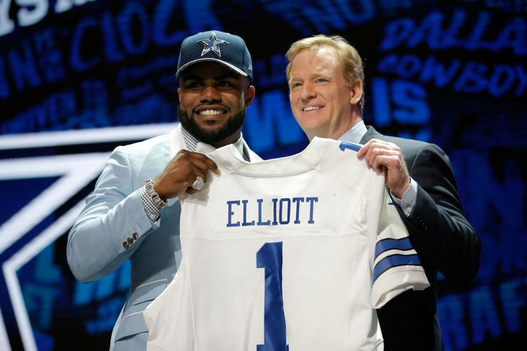 Ezekiel Elliott of Ohio State holds up a jersey with NFL Commissioner Roger Goodell after being picked #4 overall by the Dallas Cowboys during the first round of the 2016 NFL Draft at the Auditorium Theatre of Roosevelt University on April 28, 2016 in Chicago, Illinois