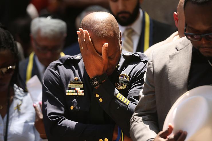 Dallas Police Chief David Brown pauses at a prayer vigil following the deaths of five police officers last night during a Black Live Matter march on July 8, 2016 in Dallas, Texas. Five police officers were killed and seven others were injured in a coordinated ambush at a anti-police brutality demonstration in Dallas. Investigators are saying the suspect is 25-year-old Micah Xavier Johnson of Mesquite, Texas