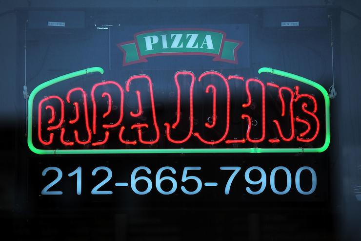A sign hangs in the window of a Papa Johns pizza restaurant on August 9, 2012 in New York City. Papa JohnÕs chief executive, John Schnatter, has stated that due to U.S. President Barack Obama's controversial health-care law he will need to raise costs by 15 to 20 cents a pizza