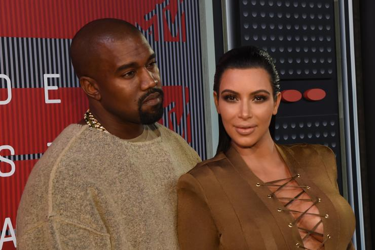 Recording artist Kayne West (L) and TV personality Kim Kardashian attend the 2015 MTV Video Music Awards at Microsoft Theater on August 30, 2015 in Los Angeles, California