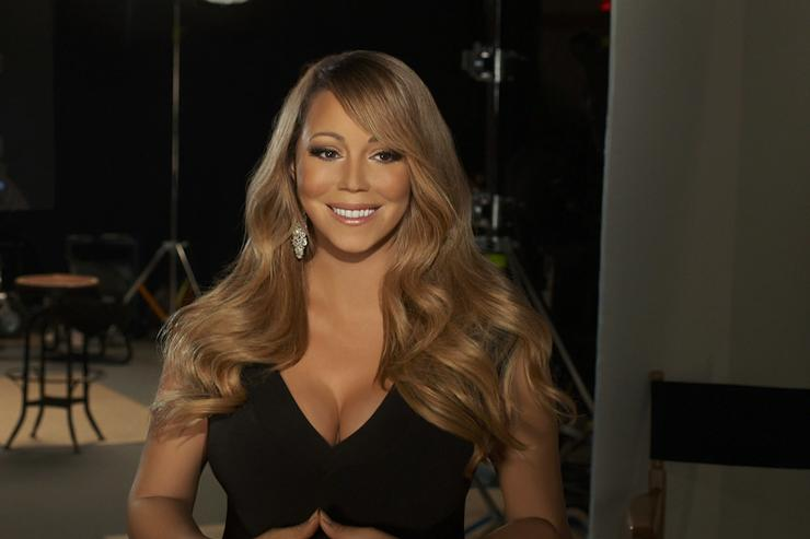 In this handout image provided by CF Publicity, Singer Mariah Carey smiles in an unspecified location on February 13, 2013. Carey has recorded the song, 'Almost Home' for the soundtrack to the Disney feature film 'Oz The Great and Powerful' directed by Sam Raimi in theatres in the US on March 8