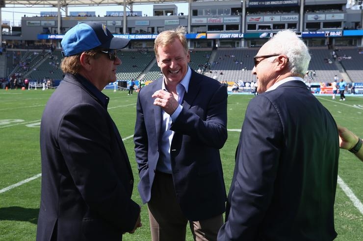 Team President and CEO Dean Spanos of the Los Angeles Chargers, Commissioner of the NFL Roger Goodell, and Owner Jeffrey Lurie of the Philadelphia Eagles talk prior to a game between the Los Angeles Chargers and Philadelphia Eagles at StubHub Center on October 1, 2017 in Carson, California