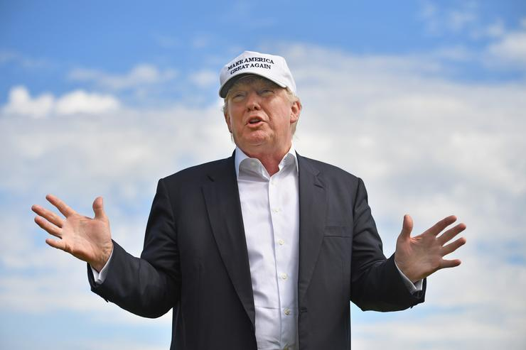 Presumptive Republican nominee for US president Donald Trump visits Trump International Golf Links on June 25, 2016 in Aberdeen, Scotland. The US presidential hopeful was in Scotland for the reopening of the refurbished Open venue golf resort Trump Turnberry which has undergone an eight month refurbishment as part of an investment thought to be worth in the region of two hundred million pounds