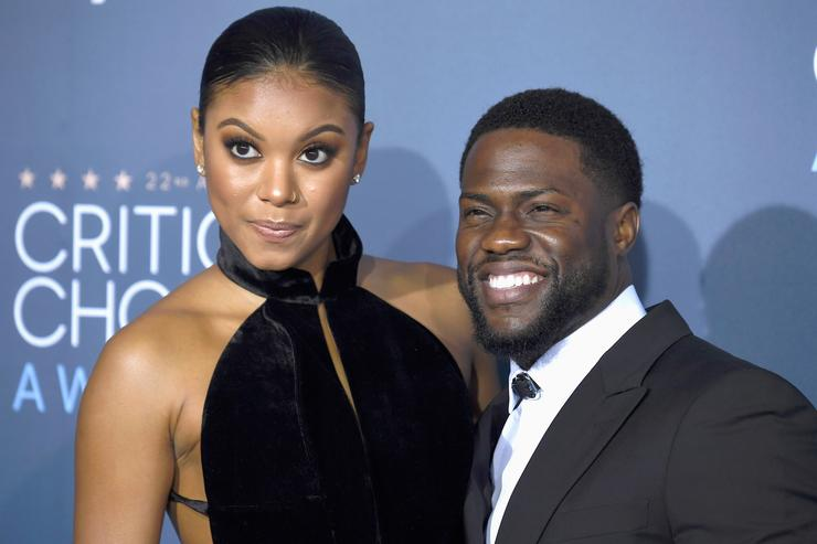 Eniko Parrish (L) and actor Kevin Hart attend The 22nd Annual Critics' Choice Awards at Barker Hangar on December 11, 2016 in Santa Monica, California
