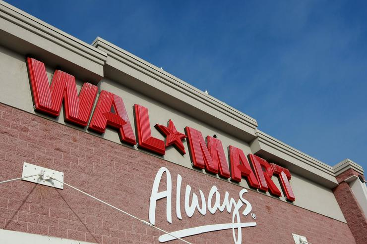 Wal-Mart races to all-time high