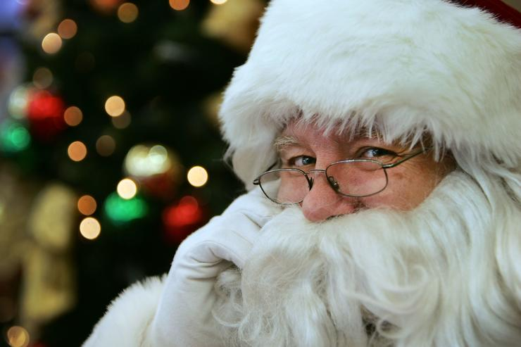 Twenty year veteran children's entertainer and actor Phil Cale dresses in his Santa suite for his 6th year playing the professional role of Father Christmas at Stanhope Gardens Shopping Centre on December 6, 2009 in Sydney, Australia