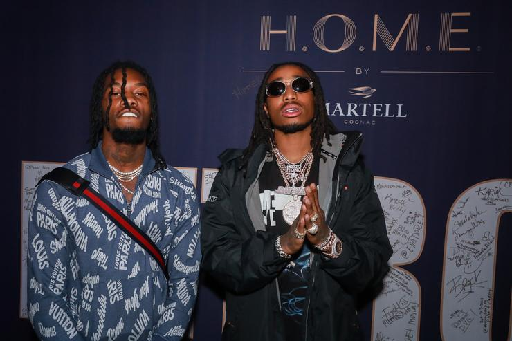 Rappers Offest and Quavo pose at the H.O.M.E. by Martell event on November 29, 2017 in Detroit, Michigan