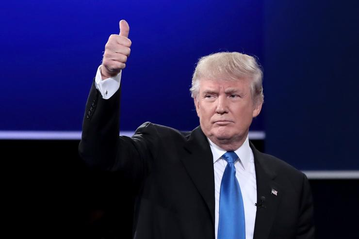 Republican presidential nominee Donald Trump waves after the Presidential Debate with Democratic presidential nominee Hillary Clinton at Hofstra University on September 26, 2016 in Hempstead, New York. The first of four debates for the 2016 Election, three Presidential and one Vice Presidential, is moderated by NBC's Lester Holt