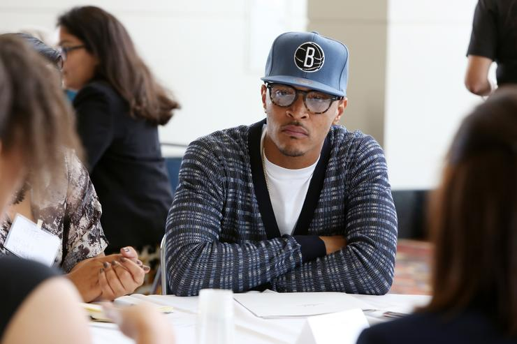 T.I. speaks with youths at a roundtable discussion at Opportunity Fair and Forum on August 13, 2015 in Chicago, Illinois