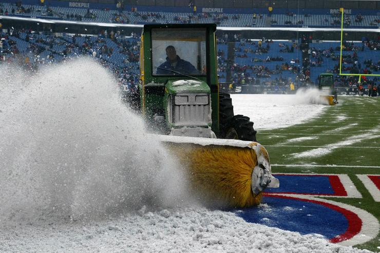 A snowplow prepares the field before during the game between the New England Patriots and the Buffalo Bills on December 11, 2005 at Ralph Wilson Stadium in Orchard Park, New York. The Pats won 35-7