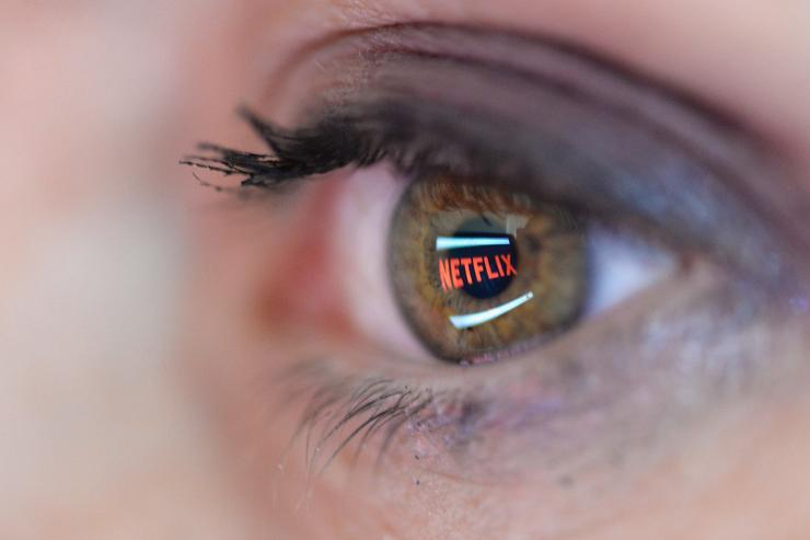In this photo illustration the Netflix logo is reflected in the eye of a woman on September 19, 2014 in Paris, France. Netflix September 15 launched service in France, the first of six European countries planned in the coming months
