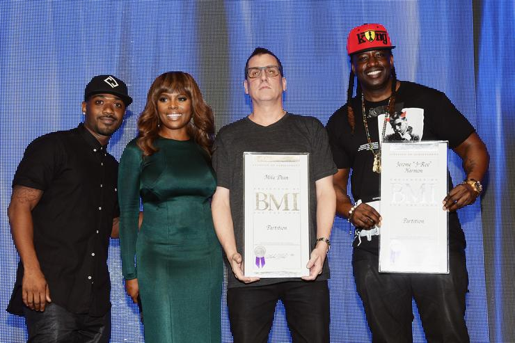Recording artist Ray J and BMI Vice President, Writer/Publisher Relations, Atlanta, Catherine Brewton present record producers Mike Dean and J-Roc onstage at the 2015 BMI R&B/Hip-Hop Awards at Saban Theatre on August 28, 2015 in Beverly Hills, California
