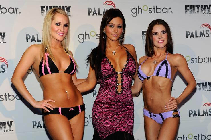 Model Ashton Wingo, television personality Jenni 'JWoWW' Farley and model Melissa Richardson present creations by Farley during the unveiling of her new 'Filthy Couture' clothing line at Ghostbar at the Palms Casino Resort July 3, 2010 in Las Vegas, Nevada