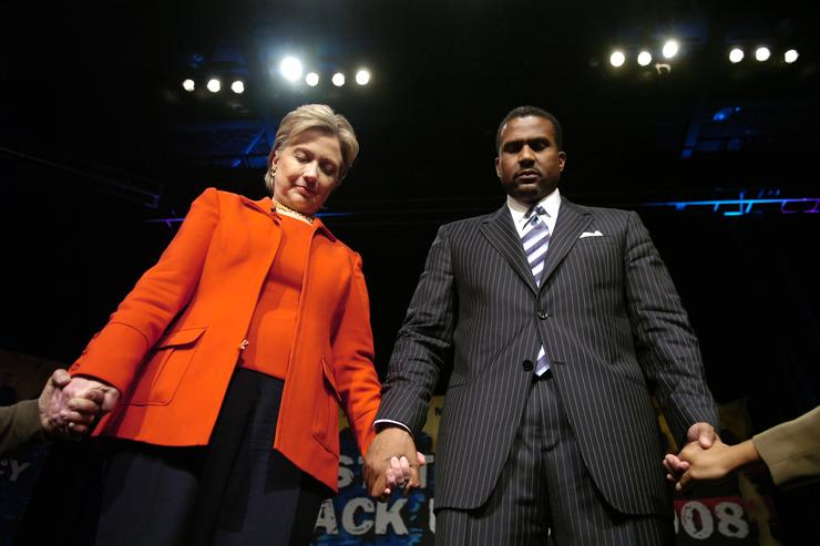 Democratic presidential hopeful Sen. Hillary Clinton (D-NY) with television talk show host Tavis Smiley hold hands with members of the crowd at the 'State Of The Black Union' symposium at the Ernest E. Morial Convention Center February 23, 2008 in New Orleans, Louisiana. Clinton earlier today heatedly accused Sen. Barack Obama (D-IL) of misrepresenting to voters her healthcare and NAFTA positions