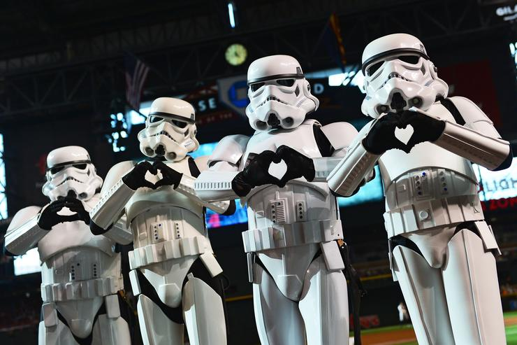 Star Wars Stormtroopers make 'hand hearts' for a photo prior to the MLB game between the San Francisco Giants and the Arizona Diamondbacks at Chase Field on May 14, 2016 in Phoenix, Arizona
