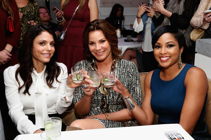 Bethenny Frankel, LuAnn de Lesseps and Alicia Quarles pose at the Gilt City Celebration of the launch of Bethenny Frankel's 'Skinnygirl Cocktails: 100 Fun & Flirty Guilt-Free Recipes' Book on October 21, 2014 in New York City