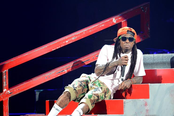 Rapper Lil Wayne performs during the America's Most Wanted Music Festival at the MGM Grand Garden Arena on August 31, 2013 in Las Vegas, Nevada