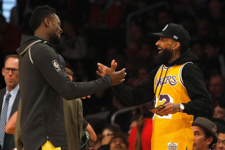 Rapper Nipsey Hussle shakes hands with Julius Randle #30 of the Los Angeles Lakers before the game against the Minnesota Timberwolves at Staples Center on December 25, 2017 in Los Angeles, California.