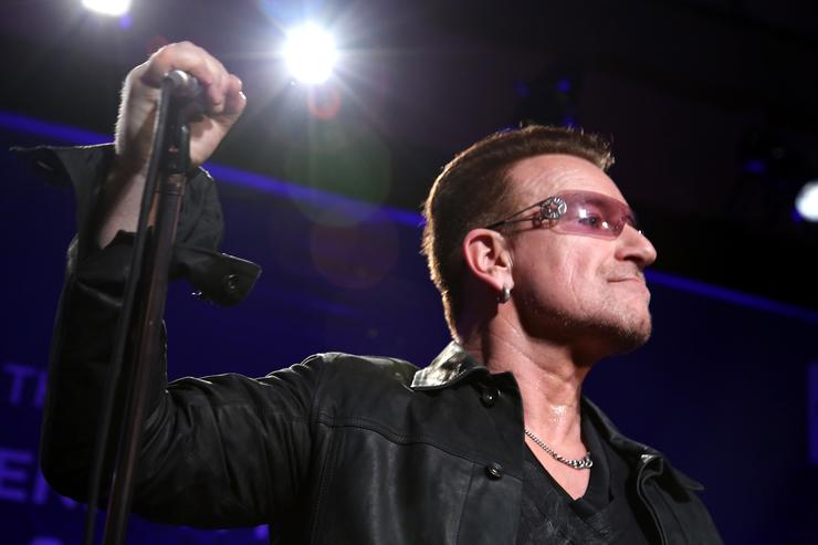 Bono of U2 performs onstage during the 3rd annual Sean Penn & Friends HELP HAITI HOME Gala benefiting J/P HRO presented by Giorgio Armani at Montage Beverly Hills on January 11, 2014 in Beverly Hills, California