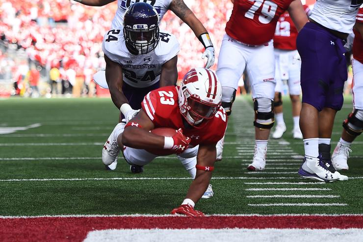 Jonathan Taylor #23 of the Wisconsin Badgers dives for a touchdown during the first quarter of a game against the Northwestern Wildcats at Camp Randall Stadium on September 30, 2017 in Madison, Wisconsin