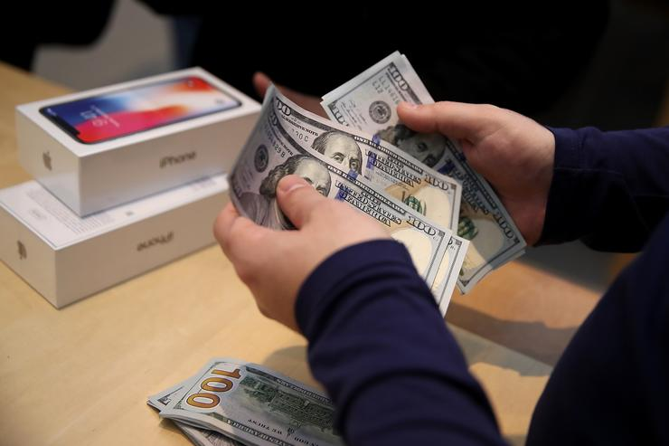 A customer purchases the new iPhone X at an Apple Store on November 3, 2017 in Palo Alto, California. The highly anticipated iPhone X went on sale around the world today