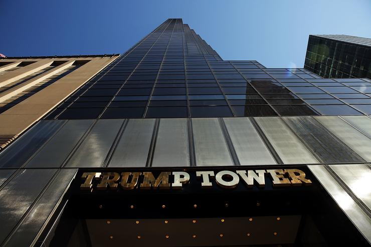 Trump Tower stands along 5th Avenue in Manhattan as police stand guard outside following an earlier protest against Republican presidential candidate Donald Trump in front of the building on March 12, 2016 in New York City. A member of the New York Police Department (NYPD) stated that the police will now keep an around the clock presence at the location due to the number of protests and threats against Donald Trump