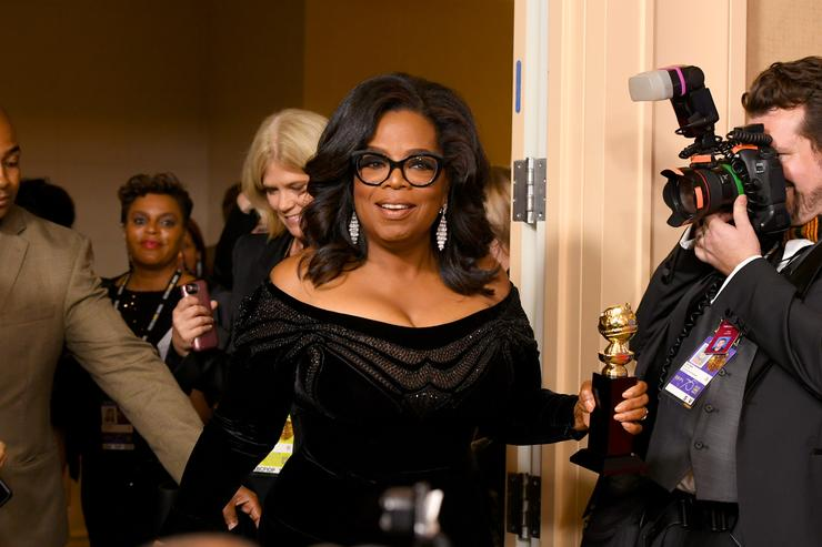 Oprah Winfrey arrives with the Cecil B. DeMille Award in the press room during The 75th Annual Golden Globe Awards at The Beverly Hilton Hotel on January 7, 2018 in Beverly Hills, California