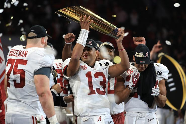 Alabama players holding the trophy