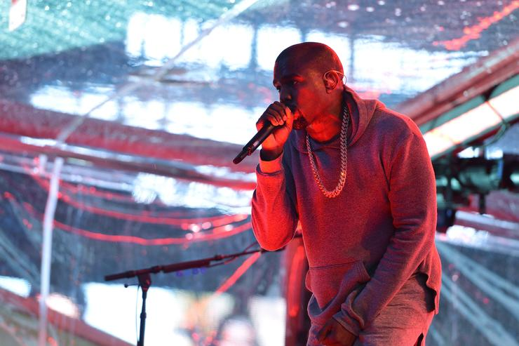 Rapper Kanye West performs on World AIDS Day at 'A (RED) Thank You,' presented by (Bank of America)RED on December 1, 2014 in New York City