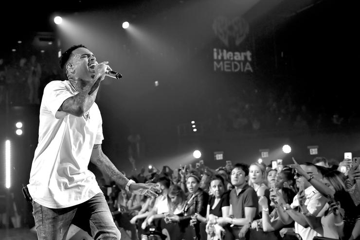 Recording artist Chris Brown performs onstage during iHeartRadio Live with special guest T.I. at the iHeartRadio Theater Los Angeles on June 19, 2015 in Burbank, California